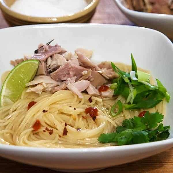 Asian Inspired Turkey Noodle Bowl - a brothy bowl of noodles using leftover Thanksgiving turkey, pasta, lime, hot chili sauce, cilantro, green onions, and soy sauce. From @NevrEnoughThyme http://www.lanascooking.com/turkey-noodle-bowl