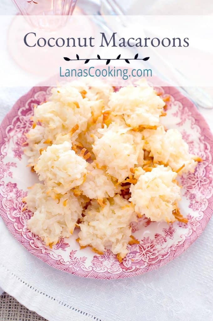 Coconut macaroons on a pink and white serving plate.
