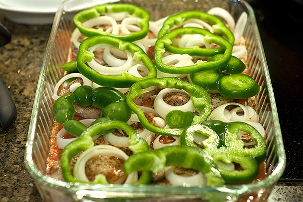 Add onions and peppers to top of casserole