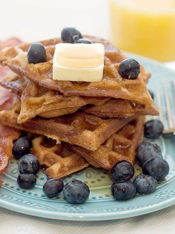 Cinnamon Brown Sugar Waffles - waffles with a brown sugar, cinnamon, and buttermilk batter. From @NevrEnoughThyme https://www.lanascooking.com/cinnamon-brown-sugar-waffles