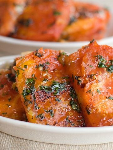 Fried Tomatoes with Garlic from @NevrEnoughThyme https://www.lanascooking.com/fried-tomatoes-with-garlic
