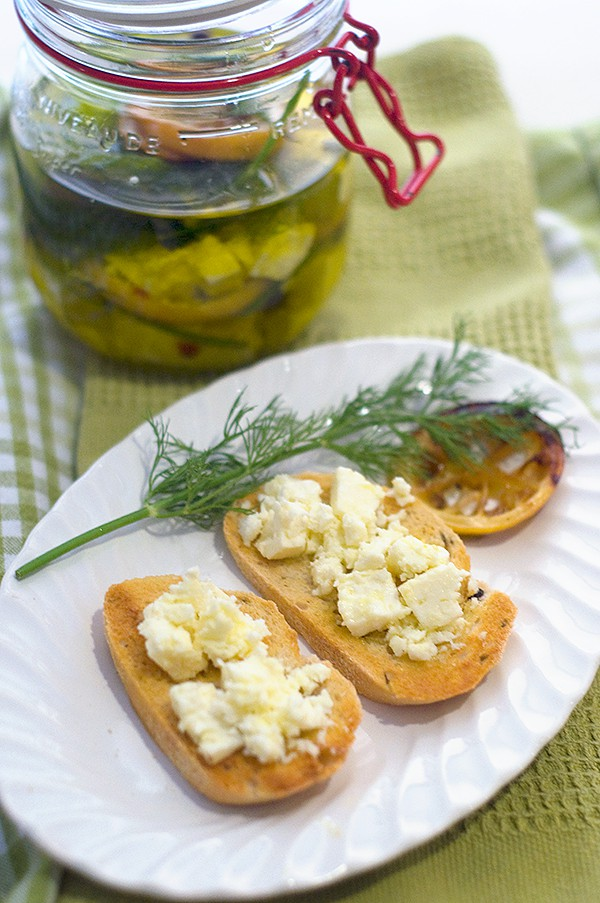 Marinated Feta with Roasted Lemon and Dill. Cubed feta marinated with olive oil, lemon, dill, and red pepper flakes. From @NevrEnoughThyme http://www.lanascooking.com/marinated-feta-roasted-lemon