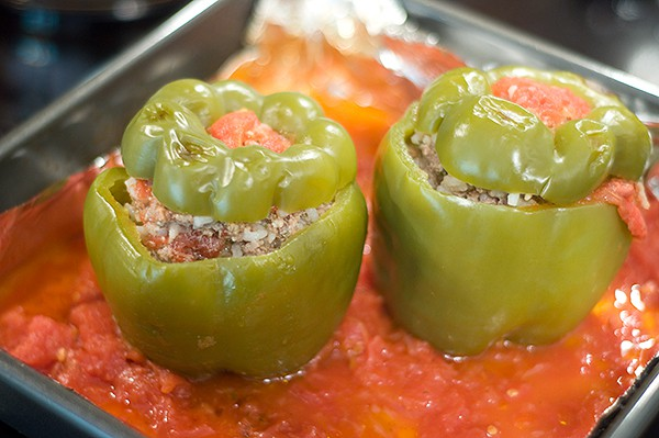 Good old Stuffed Bell Peppers - a classic stuffed with a beef and rice mixture topped with tomato sauce. From @NevrEnoughThyme https://www.lanascooking.com/stuffed-bell-peppers