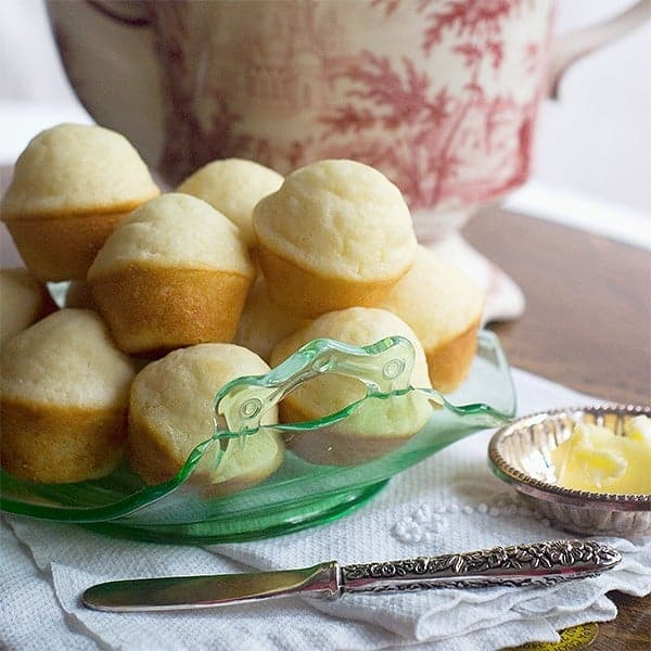 Tea Muffins - A very simple, mildly sweet muffin perfect for tea time, breakfast, or after dinner. Enjoy with lots of butter and your favorite preserves. From @NevrEnoughThyme https://www.lanascooking.com/tea-muffinsA very simple, mildly sweet muffin perfect for tea time, breakfast, or after dinner. Enjoy with lots of butter and your favorite preserves. From @NevrEnoughThyme https://www.lanascooking.com/tea-muffins