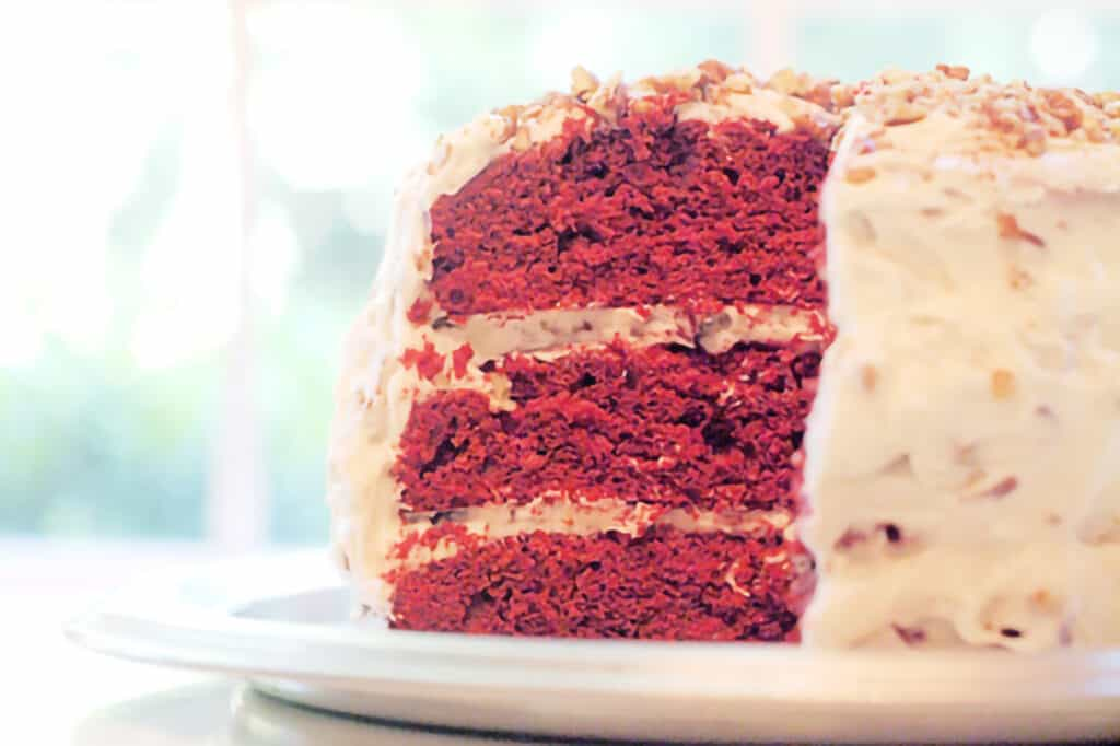 Finished red velvet cake on a cakeplate.