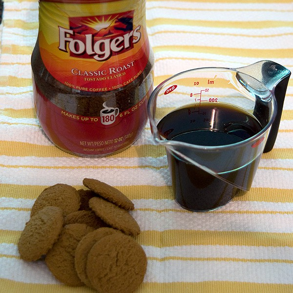 Coffee and several gingersnaps.