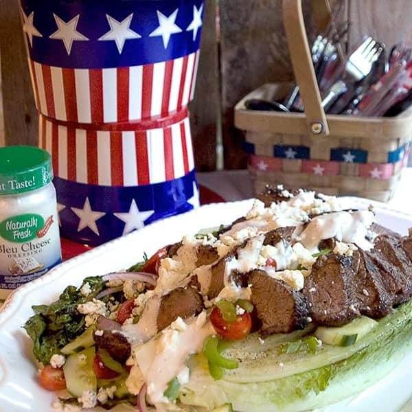 Grilled Steak Salad with Bleu Cheese Dressing - a main dish salad featuring grilled Romaine lettuce and steak topped with bleu cheese dressing. From @NevrEnoughThyme https://www.lanascooking.com/grilled-steak-bleu-cheese-salad/