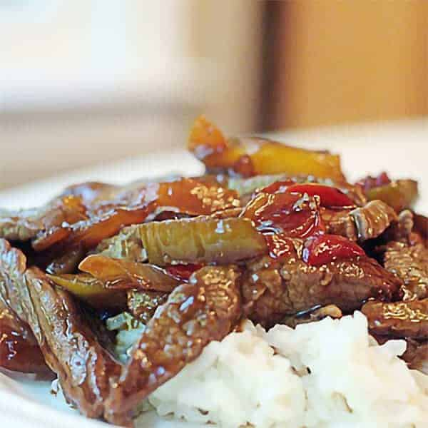 Sesame Beef Stir-Fry - a beef stir-fry with mixed vegetables seasoned with sesame oil. Serve over rice for an easy weeknight dinner. From @NevrEnoughThyme https://www.lanascooking.com/sesame-beef-stir-fry/
