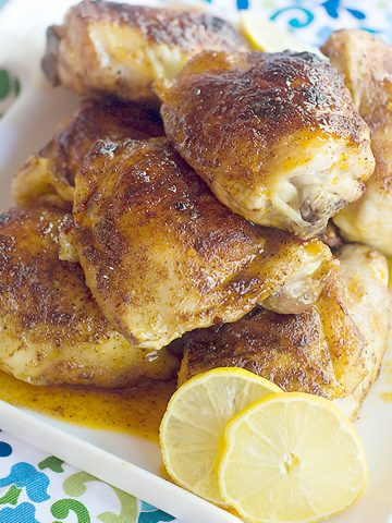 Lemon and Honey Glazed Chicken Thighs - Juicy chicken thighs coated with spices and glazed with honey and lemon. From @NevrEnoughThyme https://www.lanascooking.com/lemon-honey-glazed-chicken-thighs