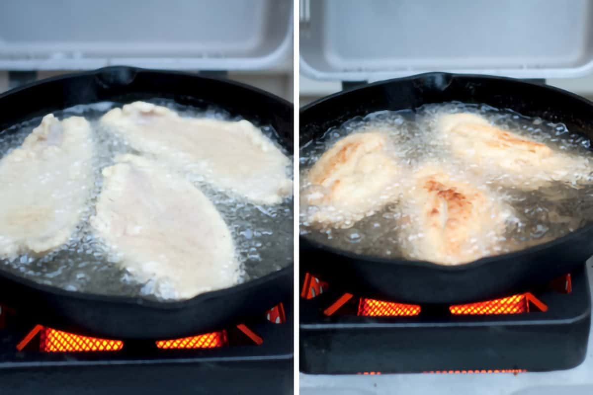 Catfish fillets frying in a cast iron pan on an outdoor grill burner