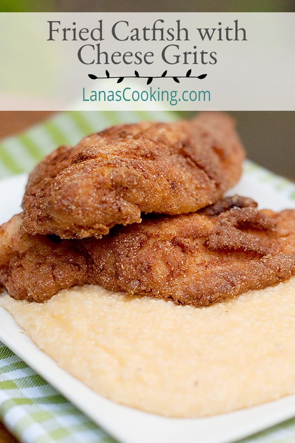 Crispy, golden brown fried catfish fillets served with a side of creamy cheese grits. The centerpiece of any southern fish fry. From @NevrEnoughThyme https://www.lanascooking.com/fried-catfish-with-cheese-grits