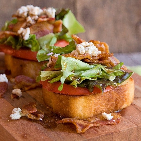 Garlic BLT Stacks - garlic bread topped with fresh tomato, bacon, lettuce, feta, and balsamic vinegar. From @NevrEnoughThyme http://www.lanascooking.com/garlic-blt-stacks