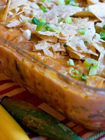Use a purchased rotisserie chicken to make prep of this delicious Southwest Chicken Casserole quick and easy. From @NevrEnoughThyme https://www.lanascooking.com/southwest-chicken-casserole