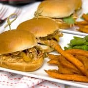 Apple Bourbon Barbecue Turkey Sliders - use purchased slow cooker sauce to make these barbecue turkey sliders quick and easy. https://www.lanascooking.com/apple-bourbon-barbecue-turkey-sliders