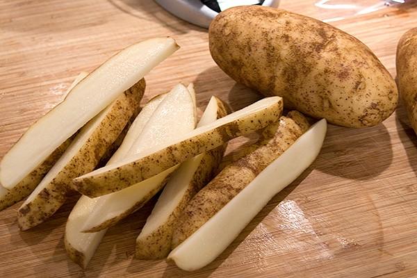 Cut potatoes into wedges