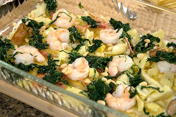 Assembly of Artichoke Spinach and Shrimp Lasagna with Bacon