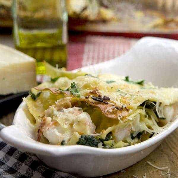 A non-traditional lasagna featuring artichoke hearts, spinach, shrimp, bacon, and Ragu's Light Parmesan Alfredo sauce. From @NevrEnoughThyme http://www.lanascooking.com-artichoke-spinach-shrimp-bacon-lasagna