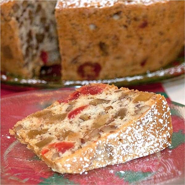A light, golden, buttery Candied Holiday Fruitcake filled with candied fruits and nuts. From @NevrEnoughThyme https://www.lanascooking.com/candied-holiday-fruitcake/