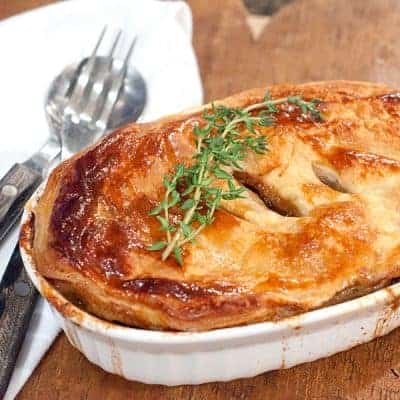 A rich, savory Beef and Stout Pie with mushrooms and onions. Wonderfully comforting traditional Irish food. From @NevrEnoughThyme https://www.lanascooking.com/beef-and-stout-pie/