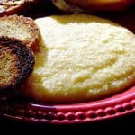 Cheese Grits - Creamy grits with cheddar cheese and a hint of garlic. Part of many a southern breakfast. From @NevrEnoughThyme https://www.lanascooking.com/cheese-grits/