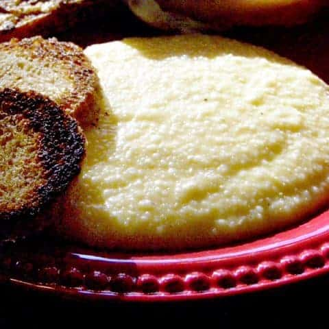 Cheese Grits - Creamy grits with cheddar cheese and a hint of garlic. Part of many a southern breakfast. From @NevrEnoughThyme http://www.lanascooking.com/cheese-grits/