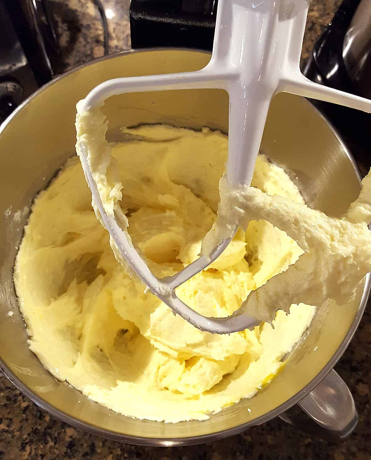 Mixing bowl with the butter, sugar, and egg mixture.