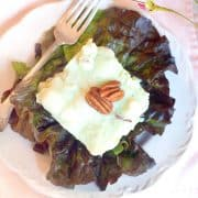 A serving of Lime Congealed Salad on a red lettuce leaf.