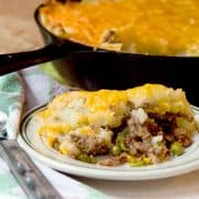 Classic Shepherd's Pie, or Cottage Pie, with ground beef and vegetables topped with creamy mashed potatoes and cheese. https://www.lanascooking.com/shepherds-pie/