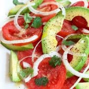 The very essence of summer! Light, refreshing, and healthy Tomato and Avocado Salad. 10 minute prep time. https://www.lanascooking.com/tomato-and-avocado-salad