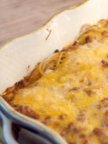 This baked spaghetti contains layers of meat sauce, spaghetti, and cheese baked until bubbly. Very kid-friendly and quick and easy for the cook. From @NevrEnoughThyme https://www.lanascooking.com/baked-spaghetti/