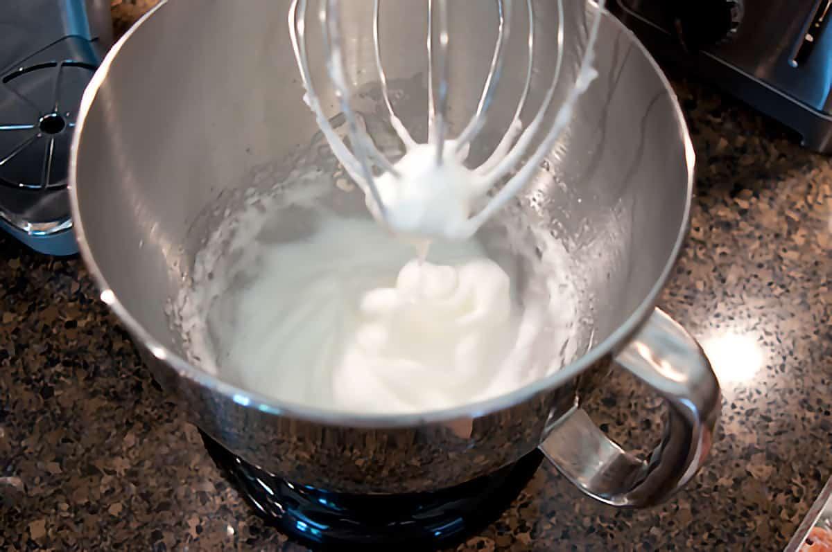 Beaten egg whites in a mixing bowl