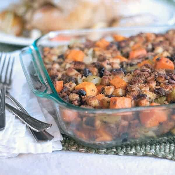 Sweet potatoes, pecans, raisins, celery, and onions combine with unseasoned bread cubes in this stuffing recipe perfect for your Thanksgiving table. From @NevrEnoughThyme https://www.lanascooking.com/sweet-potato-pecan-stuffing/