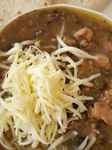 Tender pork and a mix of green chilies flavor this classic. https://www.lanascooking.com/chili-verde