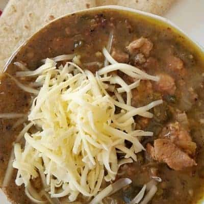 Tender pork and a mix of green chilies flavor this classic. From @NevrEnoughThyme https://www.lanascooking.com/chili-verde