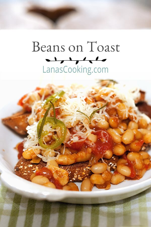 English style Beans on Toast. Baked beans enhanced with a jalapeno-rosemary oil are served over toasty whole grain bread and topped with Cheddar cheese. From @NevrEnoughThyme http://www.lanascooking.com/beans-toast