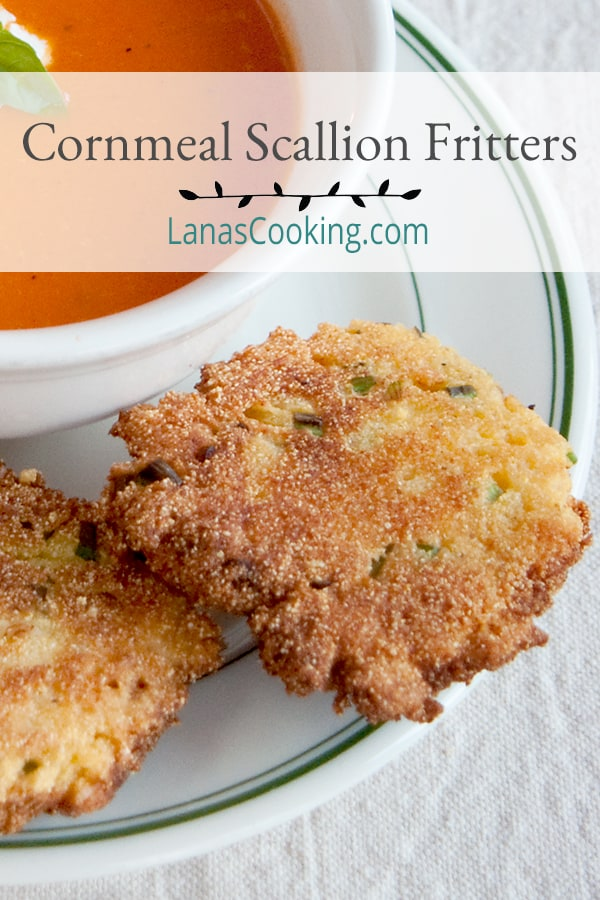 These crispy Cornmeal Scallion Fritters are the perfect accompaniment to soups and stews and are a great side with fresh summer vegetables. From @NevrEnoughThyme http://www.lanascooking.com/cornmeal-scallion-fritters/