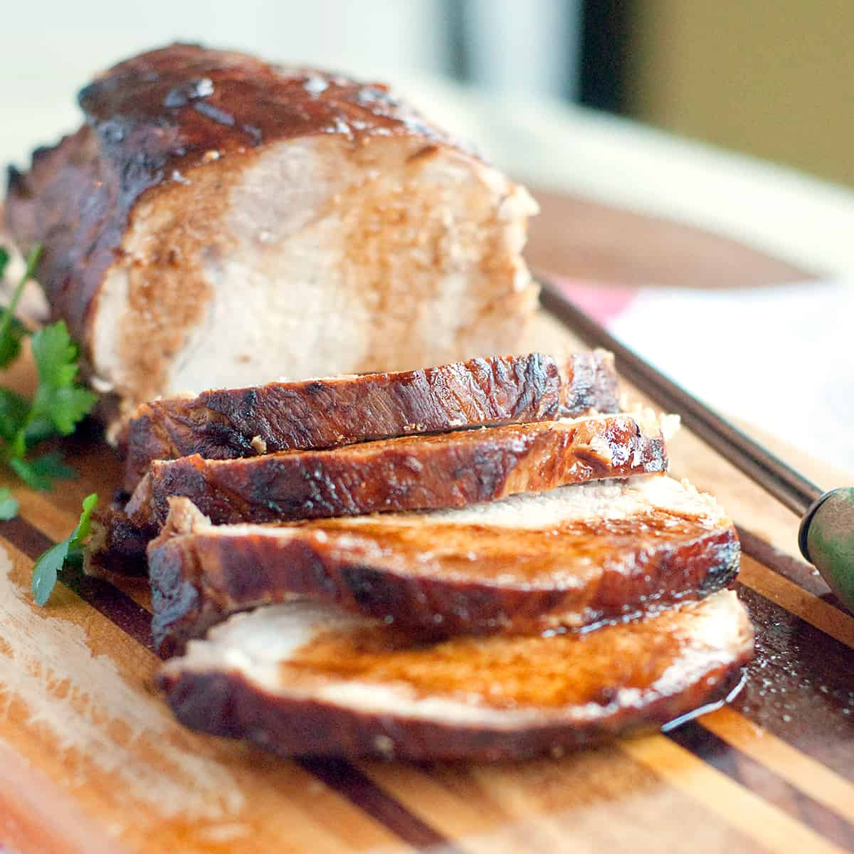 Sliced pork loin on a serving board.