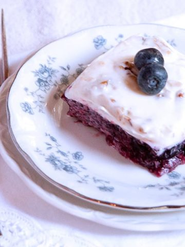 This blueberry jello salad is an old-fashioned southern recipe with blueberries and pineapple topped with a sweetened cream cheese and sour cream mixture. https://www.lanascooking.com/blueberry-jello-salad/