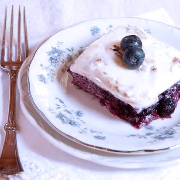 This blueberry jello salad is an old-fashioned southern recipe with blueberries and pineapple topped with a sweetened cream cheese and sour cream mixture. From @NevrEnoughThyme https://www.lanascooking.com/blueberry-jello-salad/