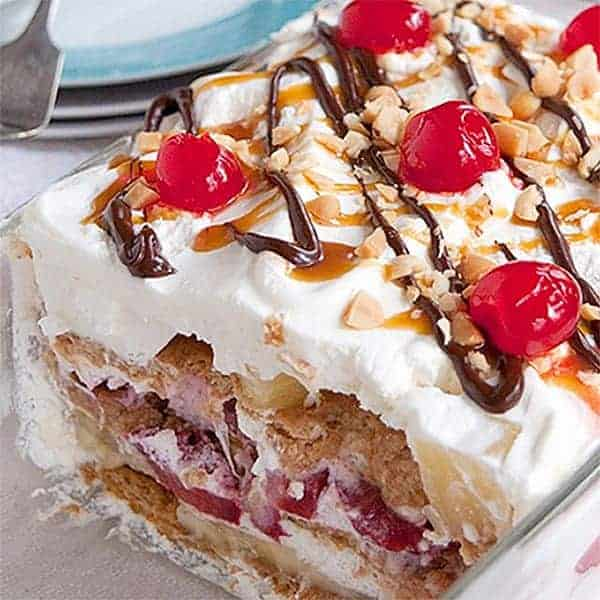 Banana Split Icebox Cake - an old fashioned dessert with layers of whipped cream, banana, strawberries, and pineapple. From @NevrEnoughThyme http://www.lanascooking.com/banana-split-icebox-cake
