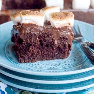Chocolate Marshmallow Poke Cake - chocolate cake, chocolate pudding, and toasted marshmallows in a fun, retro recipe that the whole family will enjoy! From @NevrEnoughThyme https://www.lanascooking.com/chocolate-marshmallow-poke-cake/
