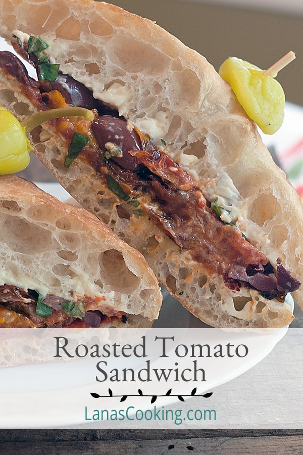 A Roasted Tomato Sandwich on a ciabatta roll layered with a flavored mayonnaise, Kalamata olives, and fresh basil. From @NevrEnoughThyme https://www.lanascooking.com/roasted-tomato-sandwich/