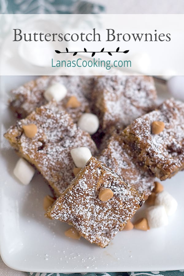 These delectable Butterscotch Brownies are just full of brown sugar, chocolate chips, pecans, and marshmallows. A nice change of pace from all chocolate. From @Nevrenougthyme https://www.lanascooking.com/butterscotch-brownies/