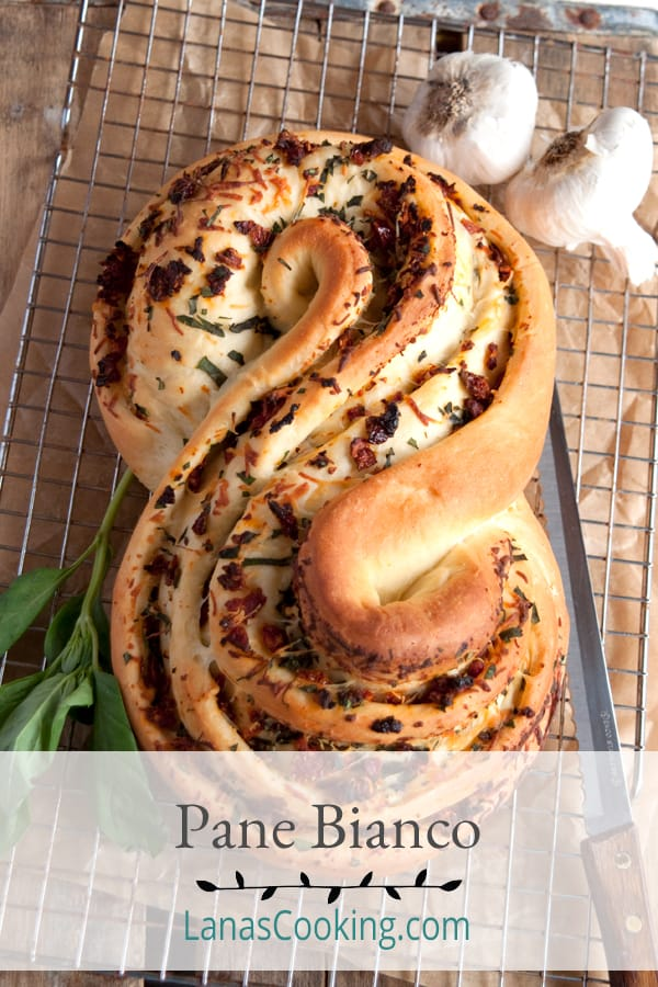 Pane Bianco Filled with Tomato, Basil, and Garlic. A soft while loaf filled with sundried tomatoes, fresh basil, cheese, and garlic. From @NevrEnoughThyme http://www.lanascooking.com/pane-bianco-filled-with-tomato-basil-and-garlic-twelveloaves