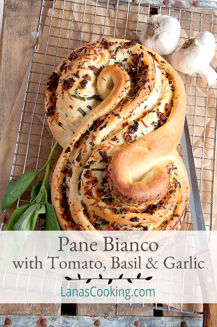 Pane Bianco Filled with Tomato, Basil, and Garlic. A soft white loaf filled with sundried tomatoes, fresh basil, cheese, and garlic. From @NevrEnoughThyme https://www.lanascooking.com/pane-bianco-filled-with-tomato-basil-and-garlic-twelveloaves