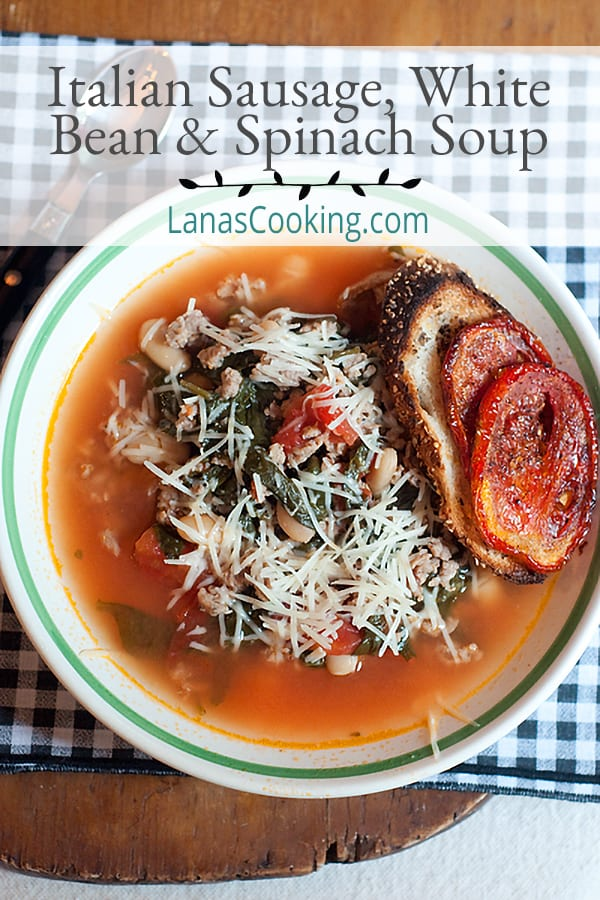 Italian Sausage, White Bean and Spinach Soup is the perfect soup for a cool Fall day. It's delicious and quick to prepare. From @NevrEnoughThyme https://www.lanascooking.com/italian-sausage-white-bean-and-spinach-soup/