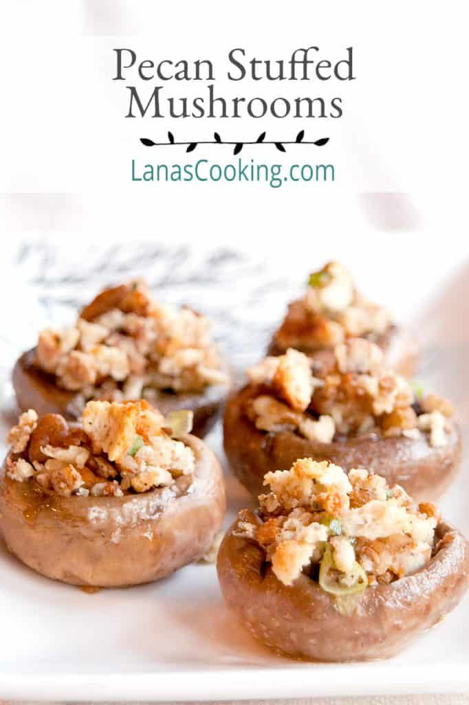 Pecan stuffed mushroom on a white serving plate.
