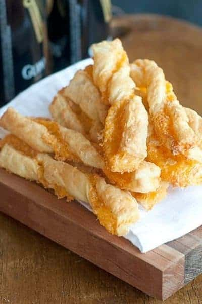 Recipe for the famous Rich's Department Store (Atlanta) Puff Pastry Cheese Straws. Sharp cheddar and Parmesan encased in light, flaky puff pastry. From @NevrEnoughThyme http://www.lanascooking.com/puff-pastry-cheese-straws/