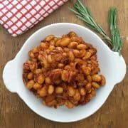 BBQ Beans - beans baked with onion, bacon, tomato sauce, and seasonings. https://www.lanascooking.com/bbq-beans/