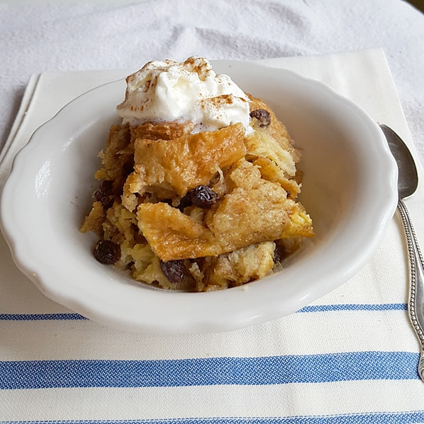 Serve Slow Cooker Bread Pudding with cream, whipped cream, or ice cream